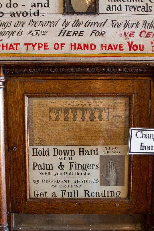 inside a penny arcade - palm reader